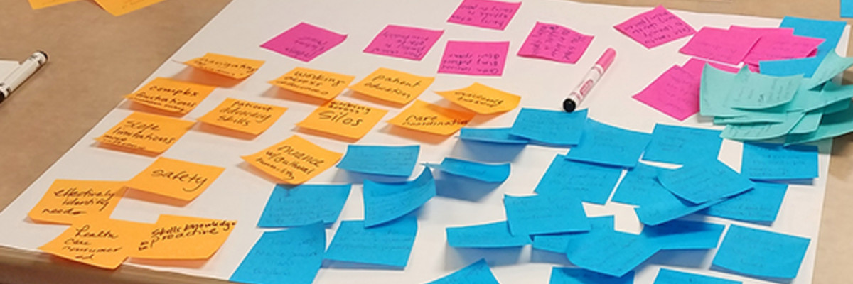 bright color post-it notes on a large white sheet